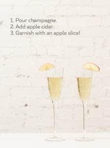 """Image of champagne flutes and text that says, """"1. Pour champagne; 2. Add apple cider; 3. Garnish with an apple slice!"""""""